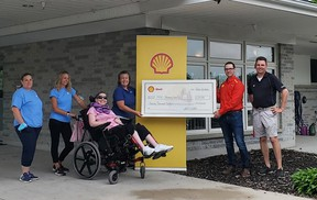 Representatives from Shell Canada drop off a $20,000 donation to the Sarnia-Lambton's Standing Oaks residence for the medically fragile. Handout/Sarnia This Week
