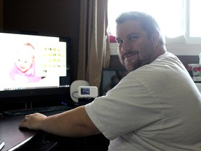Chris Roy sits in his home office in Stony Plain Aug. 6, 2020. The town resident recently published his first picture book which was inspired by his time with his daughter who is pictured on the monitor.
