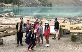 Not all visitors wear mask at the Lake Moraine in Banff Natioal Park on August 15. A noticed decreased number of visitors accounted for Parks Canada's traffic control measures, only allowing a limited number of cars to enter the area at one time. Photo Marie Conboy.