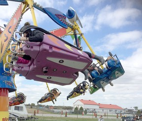 Visitors to the 2019 edition of the Brigden Fall Fair enjoy the midway. Peter Epp/Postmedia Network