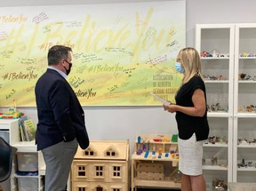 Katie Kitschke, Saffron's executive director gave Premier Jason Kenney a tour of the centre on August 13 during his local visit to the area. She outlined the high demand for counselling and the need to provide provincial funding for its public educational programming. Photo via Facebook