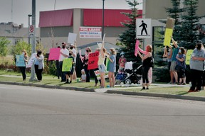 Beaumontonians held a protest outside Leduc-Beaumont MLA Brad Rutherford's office on Friday, Aug. 21 to ask the province for further educational funding for educational programs and more educational assistants in the classrooms once students go back to school in September. (Alex Boates)