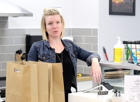 Aimee Hennig adjusts merchandise in her presently-closed The Play Café in Spruce Grove. She is puzzled by the situation she finds herself in and worries about the future of her economic baby as the pandemic days drag on.
