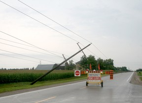 Several hydro poles were knocked over during a storm east of Mount Carmel on Aug. 27. The road was closed while hydro crews worked to restore power. Scott Nixon