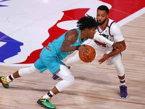 Memphis Grizzlies' Ja Morant, left, drives against Norman Powell of the Toronto Raptors during the third quarter at Visa Athletic Center at ESPN Wide World Of Sports Complex on Aug. 9, 2020 in Lake Buena Vista, Fla.