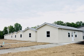 Eight new 'tiny homes' have been completed on Six Nations and were toured Friday at an official ribbon-cutting event.