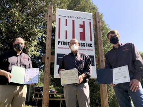 From left, Marcus Shaw, director of operations at HFI Pyrotechnics, poses with president and CEO John Witherspoon and director of technical services John Houston after the local firm was recognized by federal, provincial and municipal representatives on Friday morning. (RONALD ZAJAC/The Recorder and Times)