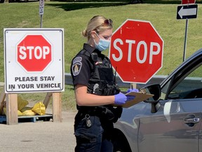 Brockville police Special Constable Bre Hamson gets information from a driver arriving at the city's COVID-19 assessment centre on Monday, Aug. 31, 2020. (RONALD ZAJAC/The Recorder and Times)