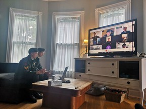 Wearing their uniforms, cadets Nick Roberts-Neef and Zach Roberts-Neef join year-end annual ceremonial review of No. 7 St. Thomas Royal Canadian Army Cadets Corps from their home. The review of the 140-year-old unit was held online because of COVID-19. (Taunyha Roberts-Neef/Contributed)