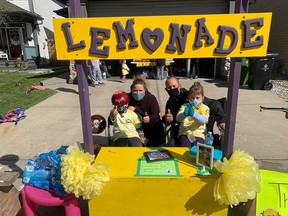 The 'Becker Bunch' raised over $1,000 for the Stollery Children's Hospital for Lemonade Stand Day on Becker Crescent in Fort Saskatchewan on Sunday, August 30. Photo Supplied