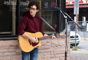 Jonah Atkins played on Norfolk St. S. during the inaugural Sounds from the Sidewalk event in downtown Simcoe. This BIA event is expected to take place for the next few Saturdays from 12:30 p.m. to 2 p.m. (ASHLEY TAYLOR)