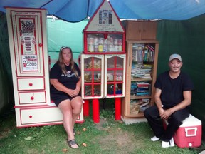 Marj Stone and Paul Skeffington have set up a little free library at their Woodworth Ave. home, stocking it with food as well as books. Eric Bunnell
