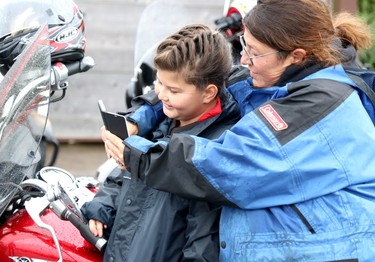Reid Vince, 9, and her mother, Tambi Vince, prepare for 27th annual Bikers Rights Organization's toy run to benefit Women in Crisis (Algoma) at A&W, 659 Great Northern Rd., in Sault Ste. Marie, Ont., on Saturday, Sept. 12, 2020. (BRIAN KELLY/THE SAULT STAR/POSTMEDIA NETWORK)
