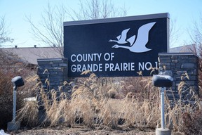 A sign outside the County of Grande Prairie administration office in Clairmont, Alta. Saturday, April 18, 2020.