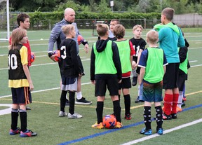 Sarnia FC Club President Adam Lakey, in grey, fourth from left, speaks to players during the club's Return to Soccer session. (Carl Hnatyshyn/Sarnia This Week)