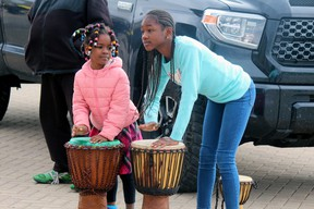Amour Boty and Anais Laubouet join in the celebration Saturday at the launch of the Nipissing Culture Days at the North Bay and Area Museum. PJ Wilson/The Nugget