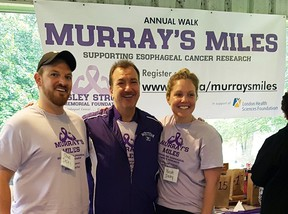 From the left are Chad Insley, Dr. Rick Malthaner, and Nicole Insley at Murray's Miles 2019. Handout