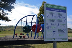 A sign gives safety tips on how to prevent the spread of COVID-19 for a playground at Riverfront Park in Peace River, Alta. on Saturday, Sept. 12, 2020.
