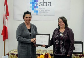 Casey Szmata (left), received the Friends of Education Award on Sept. 23. Lori Leitch, Ward Trustee presented the award to Szmata on behalf of the Peace River School Division.