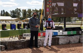 Hanover Raceway Assistant to the GM Tony Elliott presents Doug McNair with his Top Dash Winning and Top Percentage Driver awards.