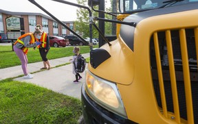 A returning pupil steps off the school bus at Lord Nelson elementary school in east London. Photograph taken on Monday September 14, 2020. Mike Hensen/The London Free Press/Postmedia Network