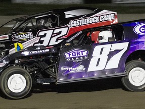 Picton's Andrew Hennessy (No. 87) took the lead from Napanee's Doug O'Blenis (No. 32) with two laps remainng to win the Bainer's OilGARD 25 Lap Canadian Modified event Saturday at Brighton Speedway. ROD HENDERSON PHOTO