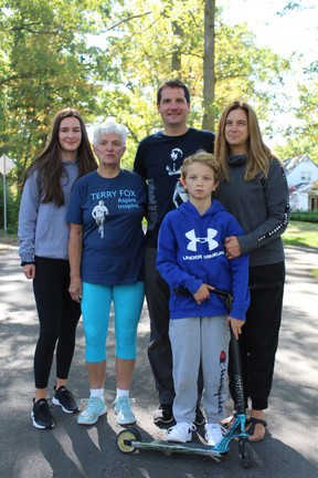 The Porteous family -- Andrew,  wife Anita, mother Jan and children Zoie and Carson -- walk through their Brantford neighbourhood on Sunday, marking the first-ever virtual Terry Fox Run.