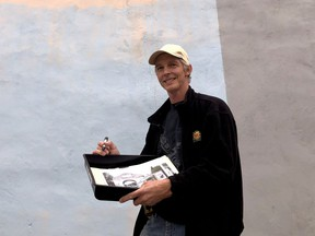 Artist Guy Wales poses by the north wall of the Brockville Tourism building, the site of the Brockville Walls Project's next mural. (RONALD ZAJAC/The Recorder and Times)