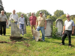The ongoing work of repairing and uprighting heritage grave markers in Chatham-Kent continues this week thanks to the dedication of volunteers with the Chatham-Kent Cemetery Restoration Project. Seen from left are volunteers Les Mancell, Bruce Warwick, Peggy O'Rourke, Tom Moore, Tom Mallard and Collin Mardling, supervisor of Chatham-Kent cemeteries as restoration work took place at Maple Leaf Cemetery in Chatham on Tuesday. (Ellwood Shreve/Chatham Daily News)