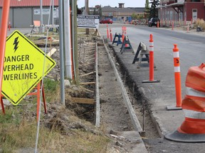 Some of the Railway Street utility work as seen September 20. Drivers should be able to move through the whole length of the street sometime next month. Patrick Gibson/Cochrane Times