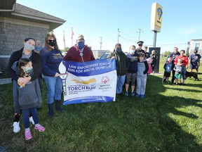 A small group of Special Olympics Ontario supporters gathered at the Lennox and Addington County Ontario Provincial Police detachment in Napanee on Saturday to complete five kilometres together for the 2020 Virtual Law Enforcement Torch Run. (Meghan Balogh/The Whig-Standard)