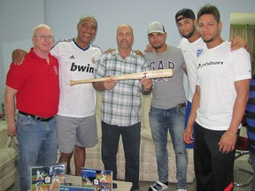 "Herardo Hernandez, a member of the Cuban 5, holds a Cubacan ""trophy"" bat while surrounded by members of Cuba's first family of baseball, the Gurriels, and bat maker Bill Ryan. From left are Ryan, Lourdes Gurriel Sr., Hernandez, ex-Baltimore Oriole Yuniesky Gurriel, current Toronto Blue Jay Lourdes Gurriel Jr. and Houston Astro Yuliesky Gurriel. (Supplied Photo)"