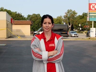 Kathryn Vandenbroek stands near the Circle K as police investigate on Tuesday September 15, 2020 in Petrolia, Ont. Vandenbroek was working the night shift when a masked suspect with a gun demanded cash. Terry Bridge/Sarnia Observer/Postmedia Network