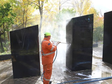Marcel Berthiaume, of Environmental 360 Solutions, uses a power washer and cleaning agent to remove graffiti from black granite sculptures located at Hnatyshyn Park near Lloyd Street hill and Notre Dame Avenue in Sudbury, Ont. on Tuesday September 29, 2020. The granite monument and Trans Canada Trail walkway in the park were vandalized with graffiti sometime this past weekend. According to Anna Johnston, executive director of the Ukrainian Seniors' Centre, it happened sometime between Friday evening and Saturday morning. John Lappa/Sudbury Star/Postmedia Network