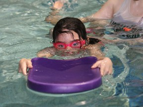 Erin Coles, 7 in this file photo, works on her swimming with the assistance of swim instructor Melodie Serre at the R.G. Dow Pool in Copper Cliff. The pool is slated to reopen reopen Sept. 14.