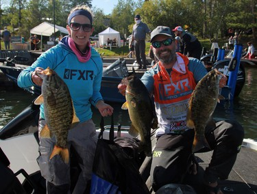 Paula and Josh Peacock from Kenora show off some of their haul during the second day of the 24th annual Bassin' For Bucks fishing tournament in Sioux Narrows on Saturday, Sept. 12.