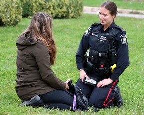A Sault Ste.Marie PoliceServiceofficer speaks with a woman following a three-vehicle crash on Second Line West on Saturday. Brian Kelly