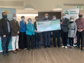 Caisse Alliance has donated a total of $100,000 to Nipissing Serenity Hospice. Caisse donated $50,000 previously when the hospice was being built and topped up its donation, Tuesday, by providing another $50,000 to help with operational expenses. Jennifer Hamilton-McCharles/The Nugget