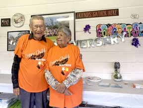 Cecil (left) and Delores Isaac at their 70th wedding anniversary on Sept. 30. Behind them is a picture of the 72-person family that all started with the couple. Jake Romphf