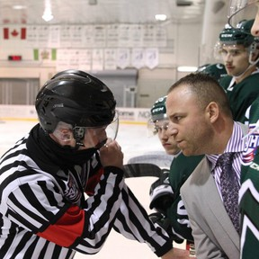 Sherwood Park Crusaders head coach Adam Manah has a chat with an official during a recent game against the Lloydminster Bobcats. Photo courtesy Target Photography