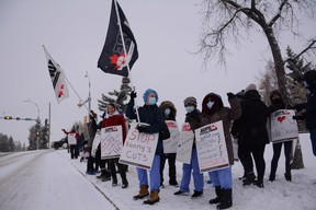 Health-care workers protest UCP cuts in front of the Queen Elizabeth II Hospital in Grande Prairie, Alta. on Monday, Oct. 26, 2020.