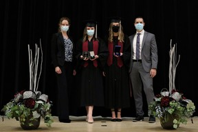 On Friday night, staff and students of the former Stratford Northwestern Secondary School participated in the school's last-ever -- and pandemic-friendly -- graduation ceremony under that school name following the recent re-organization of both of Stratford's former public high schools over the last few years. Pictured from left are Northwestern principal Emma Watts, 2020 Valedictorian Stephanie Cahill, Governor General's Award recipient Natalie Ropp, and Northwestern vice principal Derek Laidlaw. Submitted photo by Marcie Stears