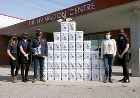 The Rapid Relief Team in Tillsonburg recently donated 40 boxes of non-perishable food to the Oxford County Community Health Centre. From left are Rapid Relief Team volunteers Kaitlyn Carpani, Kiara Prince, Roland Shaw, and Mikayla Shaw (far right) with Abbie Boesterd, OCCHC outreach worker. (Chris Abbott/Norfolk and Tillsonburg News)
