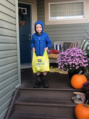 A young volunteer helps collect donations during the Church of the Latter-Day Saints food drive. Photo Supplied.