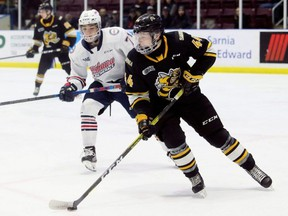Sarnia Sting's Jacob Perreault (44) protects the puck from Oshawa Generals' Ty Tullio (71) in the second period at Progressive Auto Sales Arena in Sarnia, Ont., on Friday, Jan. 10, 2020. Mark Malone/Chatham Daily News/Sarnia Observer