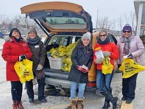 EXIT Realty Group agents collect food for Gleaners Food Bank at Marc's No Frills in Belleville recently. SUBMITTED PHOTO