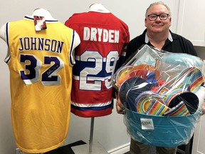 Mike Genge, president of the Children's Treatment Centre Foundation Chatham-Kent, displays some of the items that will be available to bid on during the online auction for the upcoming Festival of Giving. Submitted