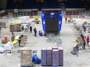 Some of the many volunteers helping with the latest food hamper project, underway on the arena floor at the civic complex. Photo on Tuesday, October 6, 2020, in Cornwall, Ont. Todd Hambleton/Cornwall Standard-Freeholder/Postmedia Network