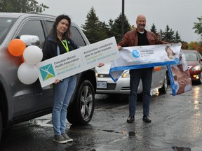 Angele D'Alessio, mental health promoter for the Canadian Mental Health Association Champlain East and Ivan Labelle of the Centre de santé communautaire de l'Estrie were all smiles during the Mental Illness Awareness Week car parade, on Wednesday October 7, 2020 in Cornwall, Ont. Francis Racine/Cornwall Standard-Freeholder/Postmedia Network