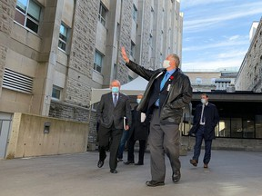 Hastings-Lennox and Addington MPP Daryl Kramp waves goodbye after announcing funding for Kingston Health Sciences Centre in Kingston on Friday. (Elliot Ferguson/The Whig-Standard)
